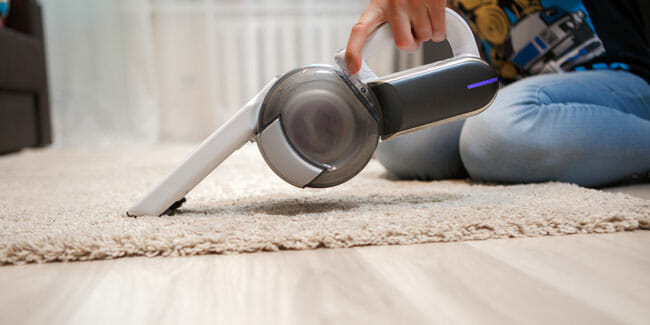 Cleaning of rug in house portable vacuum cleaner